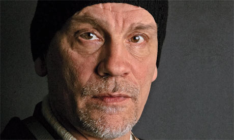 John-Malkovich-at-the-Sun-001.jpg